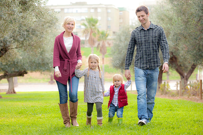 Family mum dad and kids. Outdoors royalty free stock image