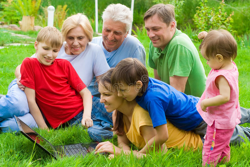 Family at nature with laptop stock photo