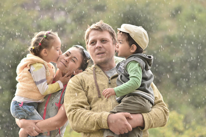 Family in nature on a rainy day with children. Foto outdoor on a rainy day royalty free stock photos
