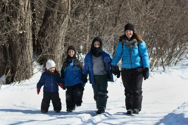 Family in nature during winter royalty free stock image