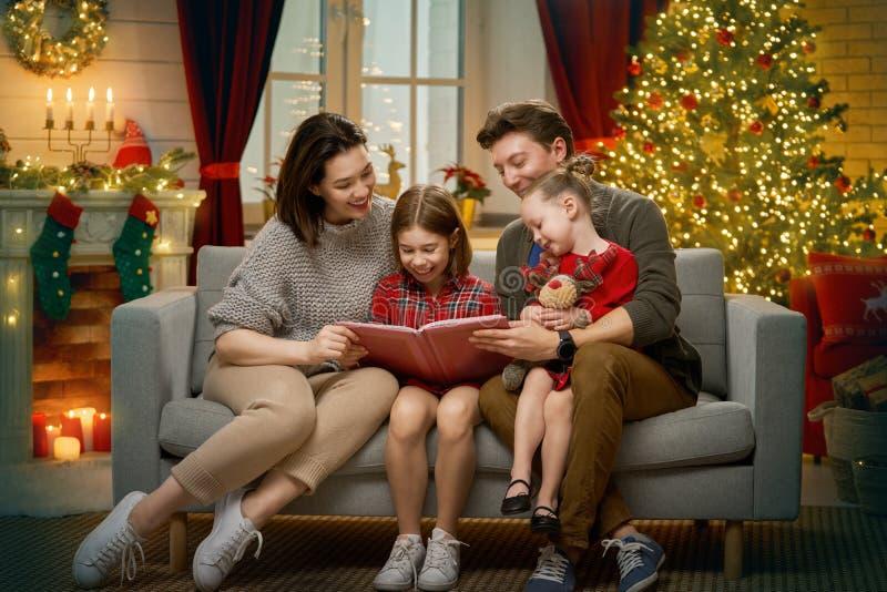 Family near Christmas tree stock images