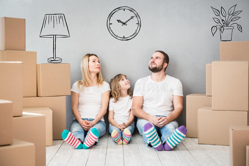 Family New Home Moving Day House Concept. Happy family playing into new home. Father, mother and child having fun together. Moving house day and real estate