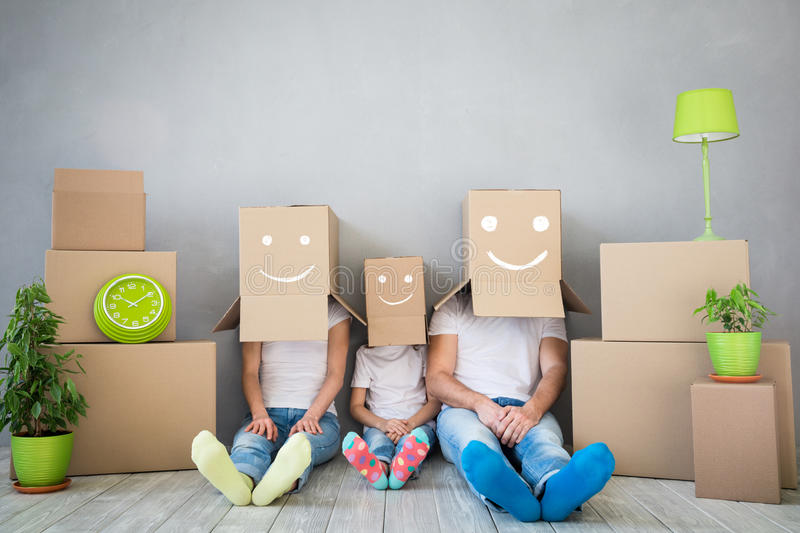 Family New Home Moving Day House Concept. Happy family playing into new home. Father, mother and child having fun together. Moving house day and `think outside royalty free stock image