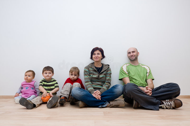 Family in new house stock photography