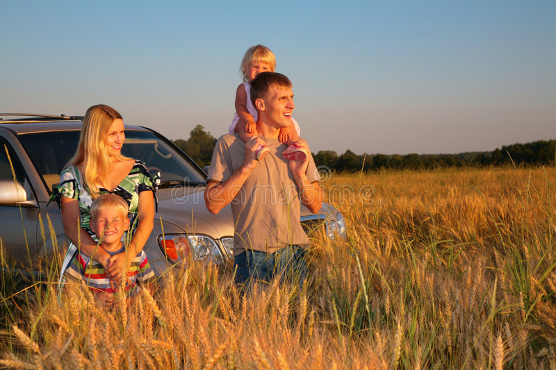 Family with offroad car on wheaten field. Family with offroad car on a wheaten field royalty free stock photo