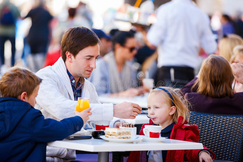 Family at outdoor cafe stock photography