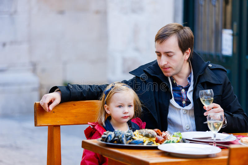 Family at outdoor restaurant stock image