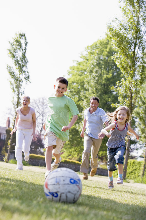 Family outdoors playing soccer and having fun stock photos