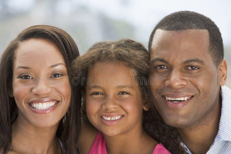 Family outdoors smiling royalty free stock photos