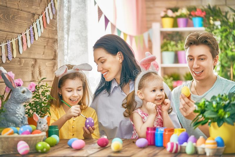 Family are painting eggs royalty free stock photography