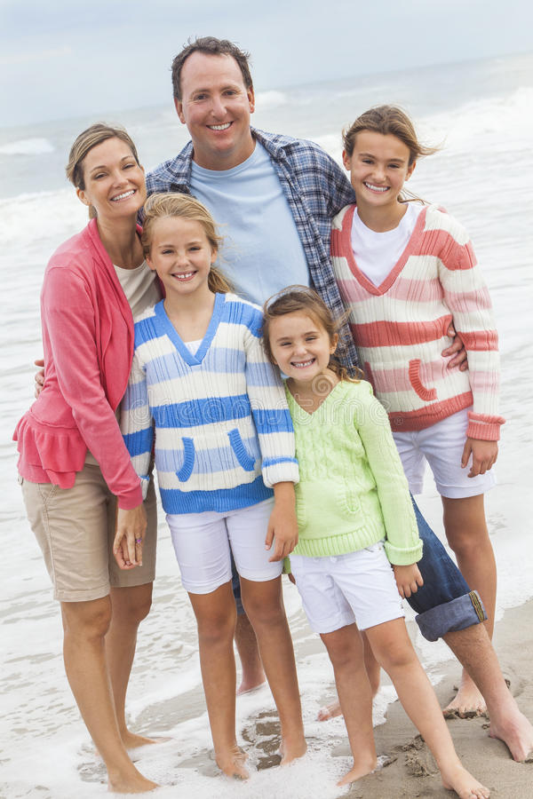 Family Parents Girl Children Vacation on Beach stock image