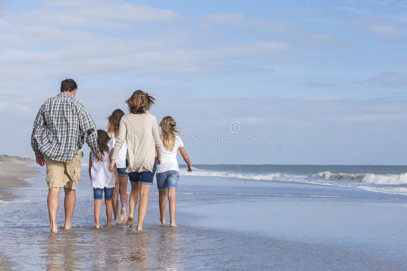 Family Parents Girl Children Walking on Beach royalty free stock photography