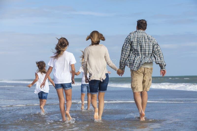 Family Parents Girl Children Walking on Beach stock images