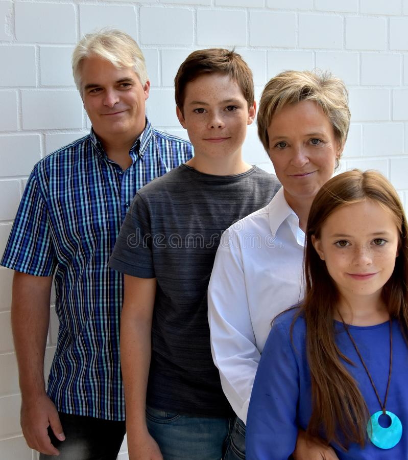 We are family, father mother and two teenagers stock photography