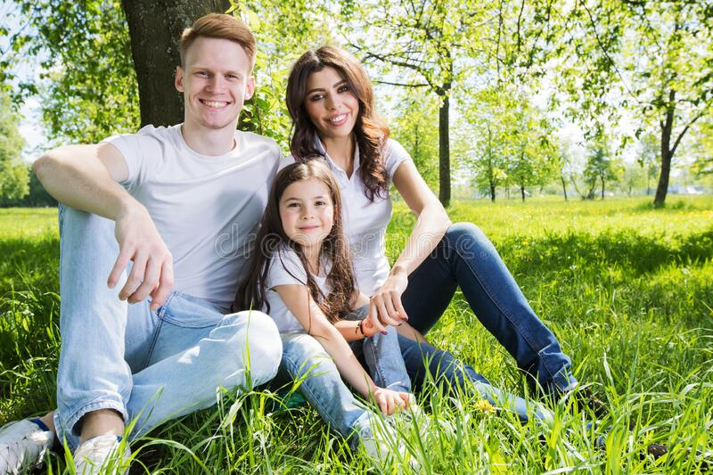 Family on park meadow royalty free stock photo