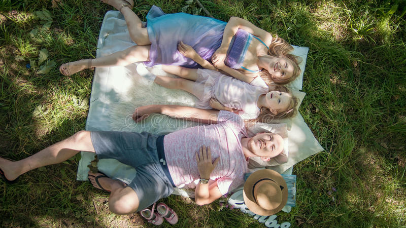 Family in park at picnic - father, mother and daughter - top view stock photos