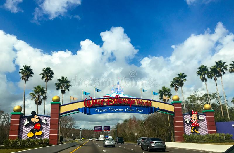 Entering Walt Disney World in Orlando, Florida. Family pass through the entrance of Walt Disney World in Orlando, Florida stock images