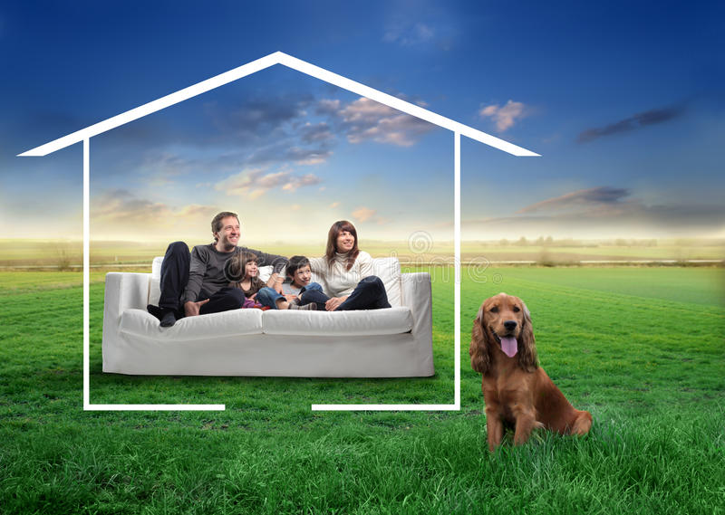 Family with pet. Portrait of a smiling family sitting in a couch and surrounded by the form of a house and a dog next to them