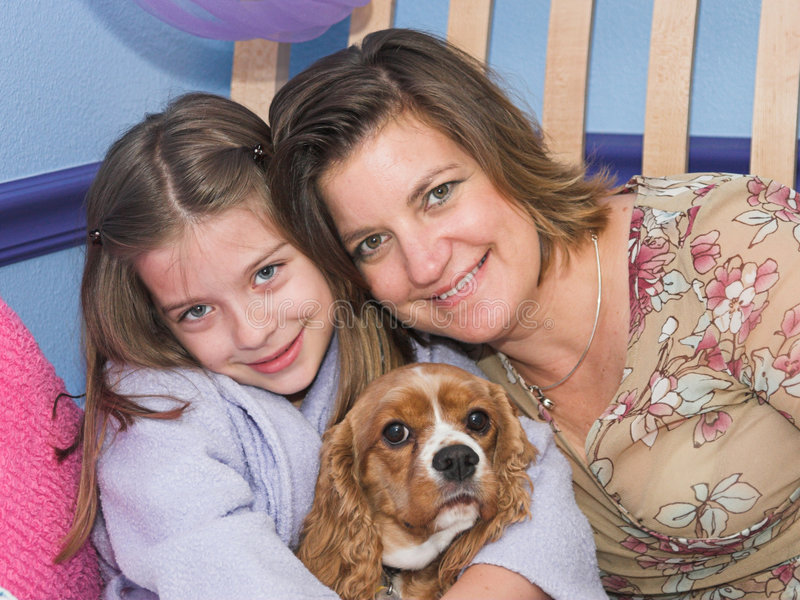 The Family Pet. A mother and daughter posing with their cavalier spaniel dog