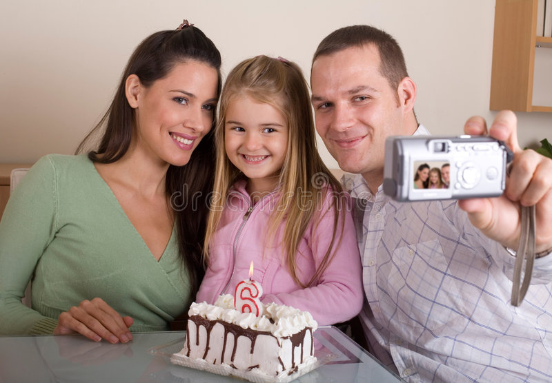 Family photo for birthday. Father is taking family photo for daughter`s 6 birthday royalty free stock image