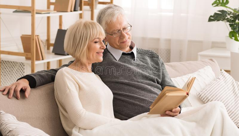 Family Photoalbum. Elderly Couple Looking At Photos royalty free stock photos