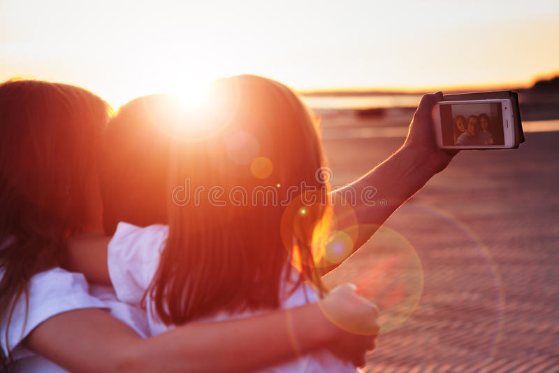 Family is photographed selfie. stock images
