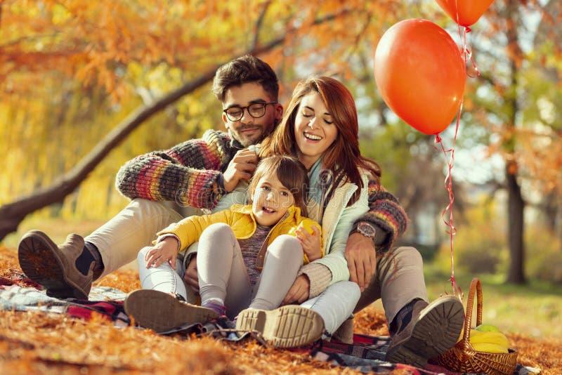 Family picnic in autumn stock image