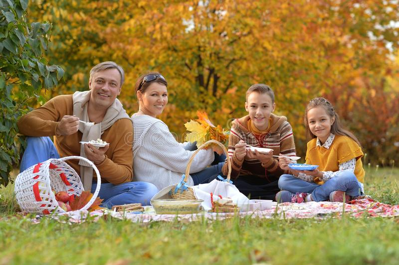 Family on picnic in autumn royalty free stock photo