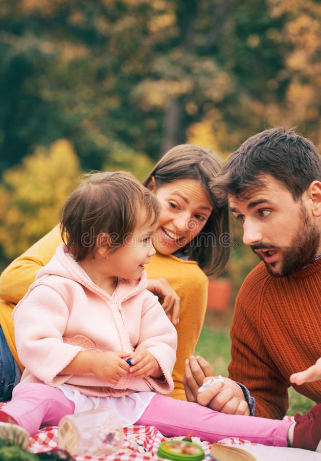 Family on picnic in autumn park. royalty free stock photography