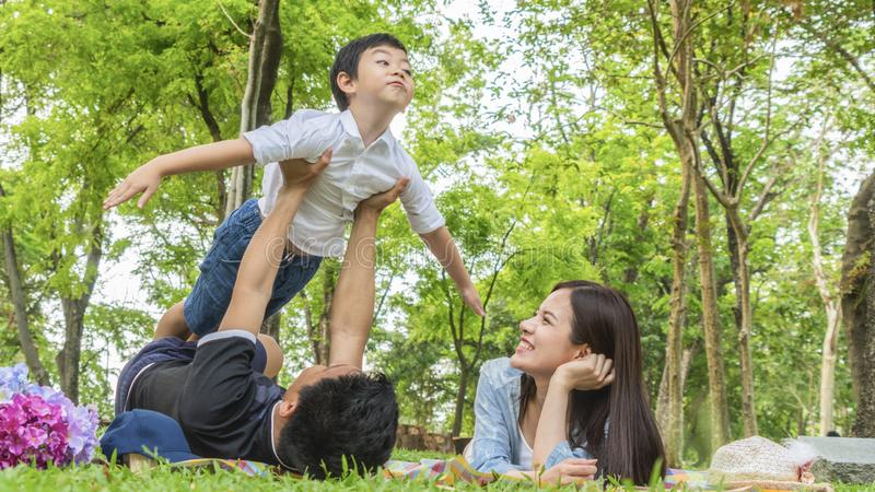 Family Picnic at gaden park Outdoors Togetherness Relaxation Con stock photo