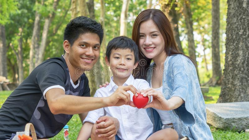 Family Picnic at gaden park Outdoors Togetherness Relaxation Con stock image