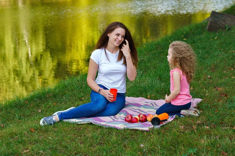 Family picnic. Mother and daughter stock photos