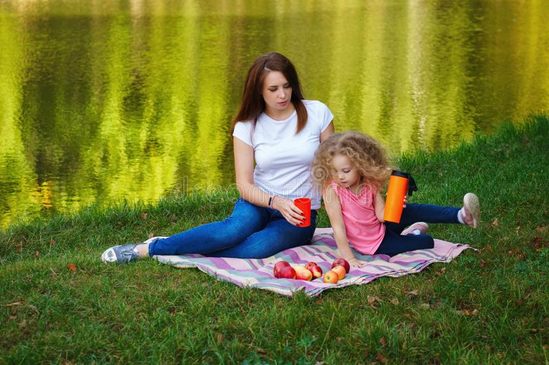 Family picnic. Mother and daughter royalty free stock photos