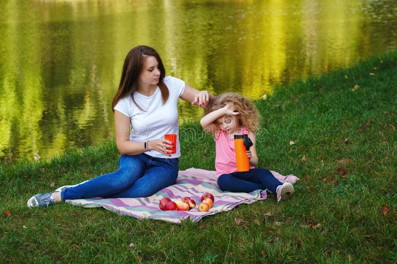 Family picnic. Mother and daughter stock photo