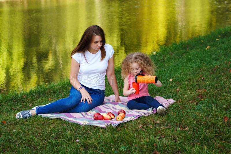 Family picnic. Mother and daughter stock image