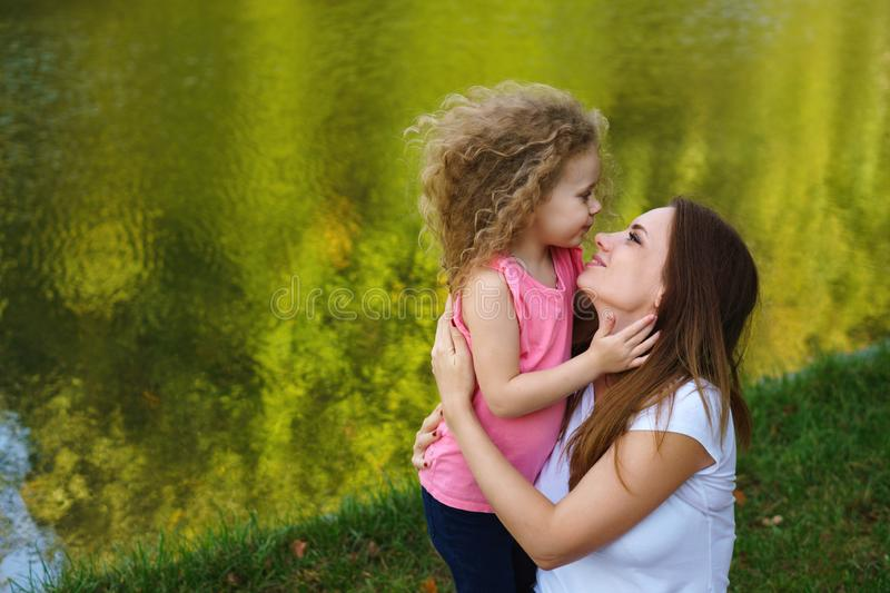 Family picnic. Mother and daughter royalty free stock image