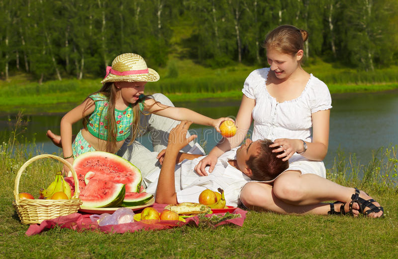 Family picnic in park royalty free stock images
