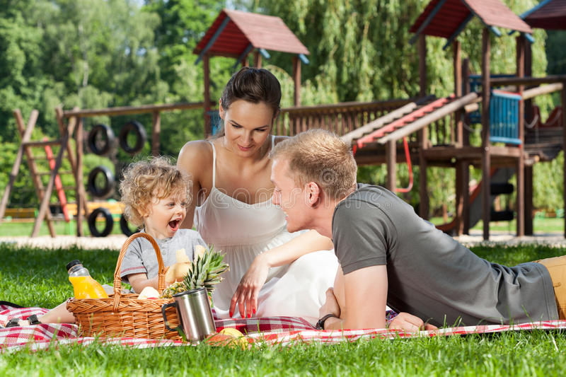 Family picnic on the playground. During sunny day royalty free stock photo