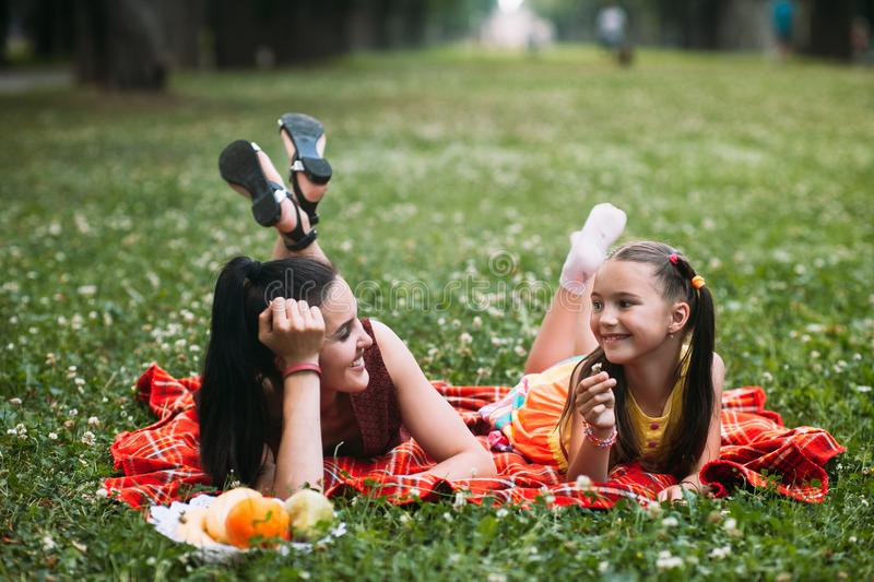 Family picnic relax conversations concept. stock images
