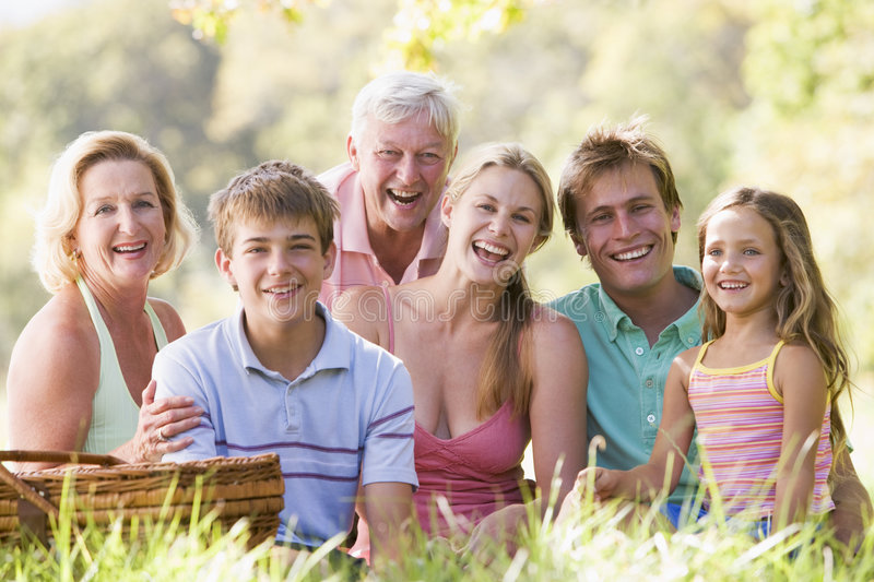 Family at a picnic smiling royalty free stock photography