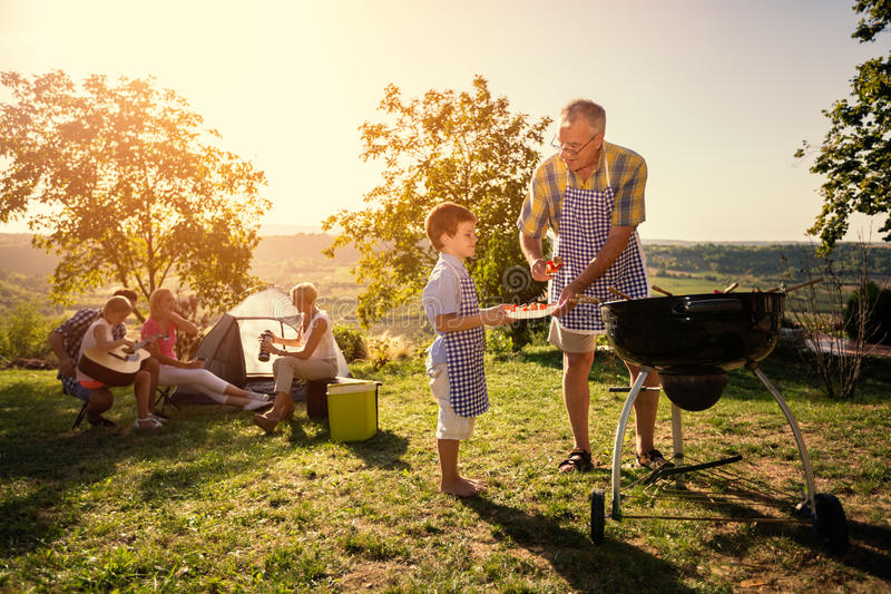 Family picnik with barbecue stock photo