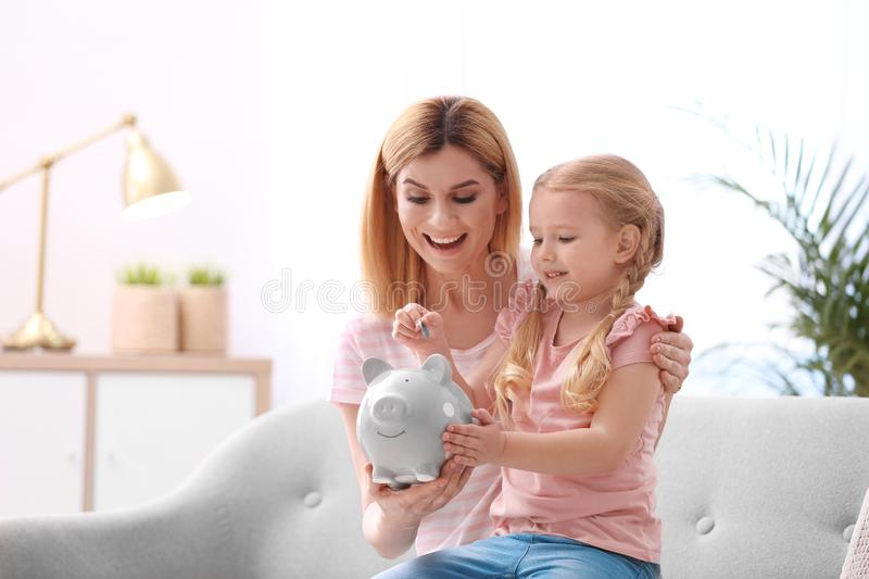 Family with piggy bank and money stock photo