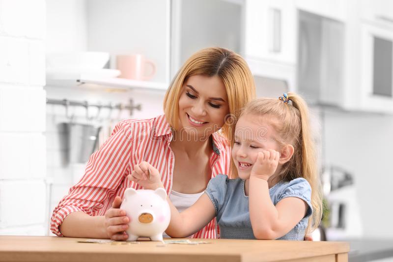 Family with piggy bank and money royalty free stock image