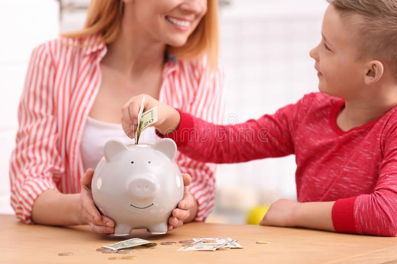 Family with piggy bank and money stock image