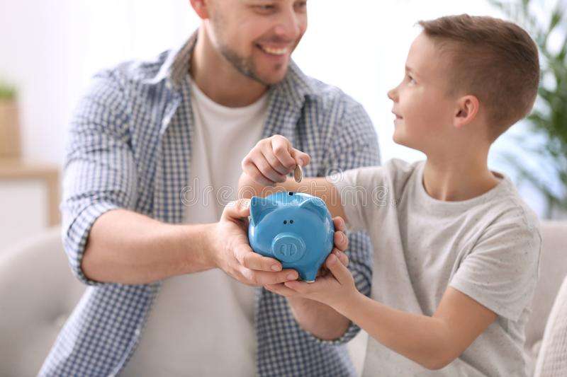Family with piggy bank and money stock images