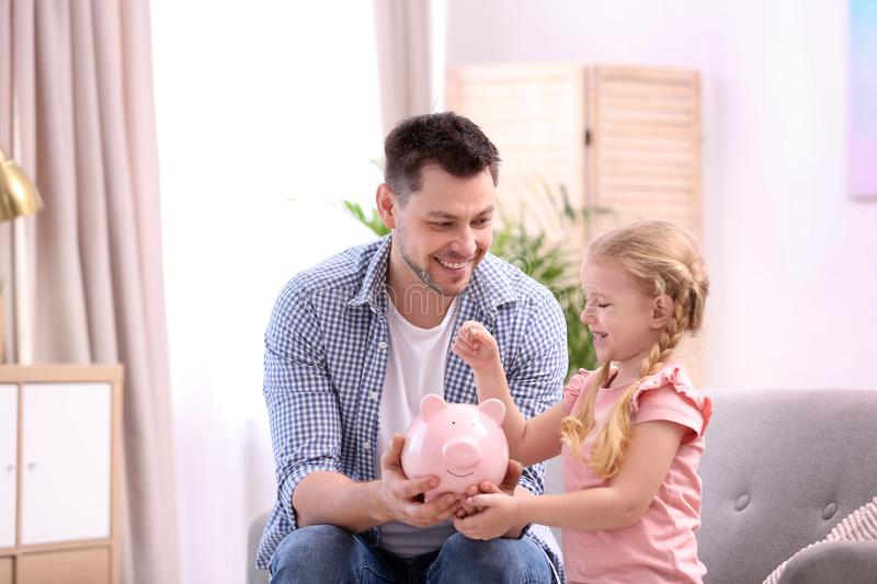Family with piggy bank and money royalty free stock photography