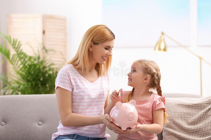 Family with piggy bank and money stock photography