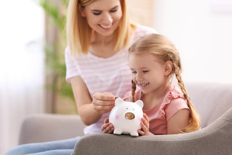 Family with piggy bank and money royalty free stock images