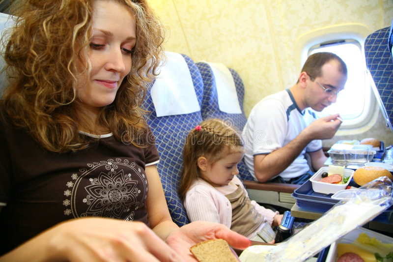 Family in plane stock images