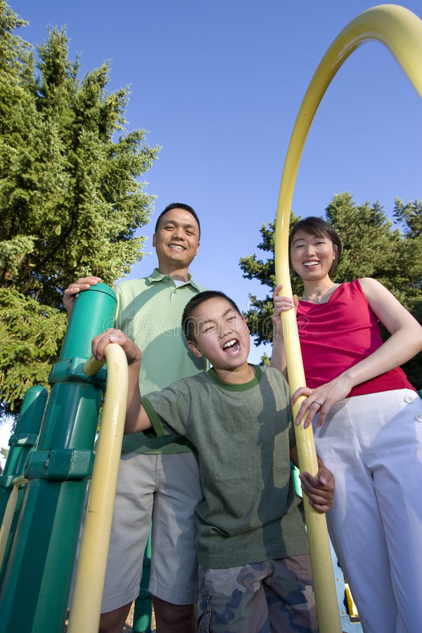 Download Family On Playground Smiling - Vertical Stock Photo - Image: 5975460